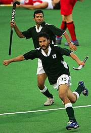 Shakeel Abbasi of Pakistan directs play in a close victory over England.