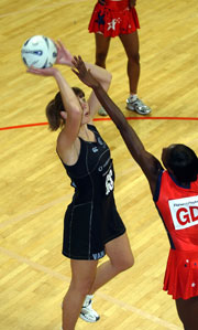 New Zealand netball player Irene van Dyke shooting for goal.