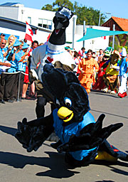 Games mascot Karak falls over the finish line after racing the other resident team mascots.