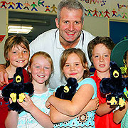 Andrew Gaze with students of Clifton Hill Primary School.