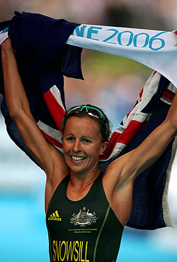 First time Commonwealth Games competitor and world champion, Emma Snowsill, triumphs with a gold medal finish - Australia's first gold at Olympic or Commonwealth Games level.