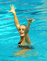 Marie Pier Boudreau Gagnon of Canada takes gold in the Synchronised Swimming.