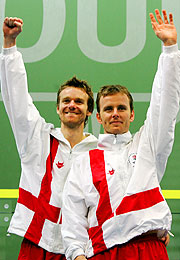 Peter Nicol and Lee Beachill of England salute the crowd.