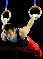 Alexander Adam Wong, a member of Canada's gold medal Artistic Gymnastics team, competes on the rings during the Men's Team competion.