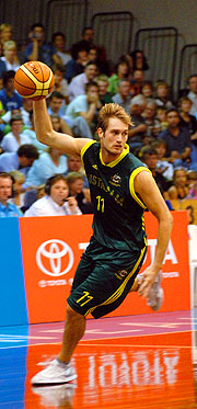 Australia's Jason Smith drives down the court in front of an excited home crowd.