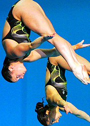 Loudy Tourky and Chantelle Newbery dive for gold in the Women's Synchronised 10m Platform.
