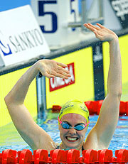 Danni Miatke celebrates her gold medal win in the 50m Butterfly.
