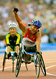 Canada's Petitclerc claims a record on her way to winning gold in the 800m.