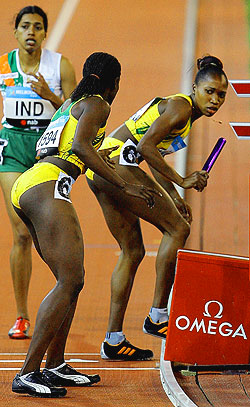 Jamaica's Novlene Williams drops the baton as she attempts to pass it to Shellene Williams