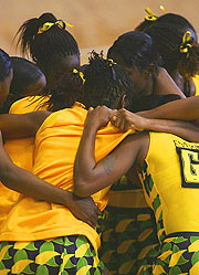 Jamaican players embrace after a last minute goal secured them a draw against Australia.
