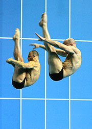 Tony Ally (L) and Mark Shipman of England won silver in Men's 3m synchronised Springboard. One of Ally's dives scored the perfect 10.