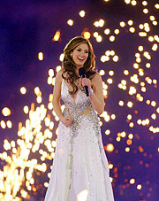 Singer Delta Goodrem performs amidst the fireworks of the Opening Ceremony.