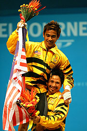 Weightlifter Baharom celebrates his gold with Malaysian teammate Guntali.