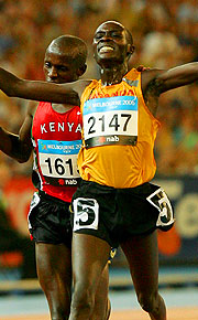 Boniface Kiprop Toroitich of Uganda crosses the line in the Men's 10,000m Final.